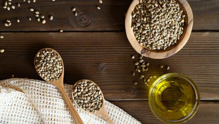 hemp seeds and hemp seed oil on wooden board