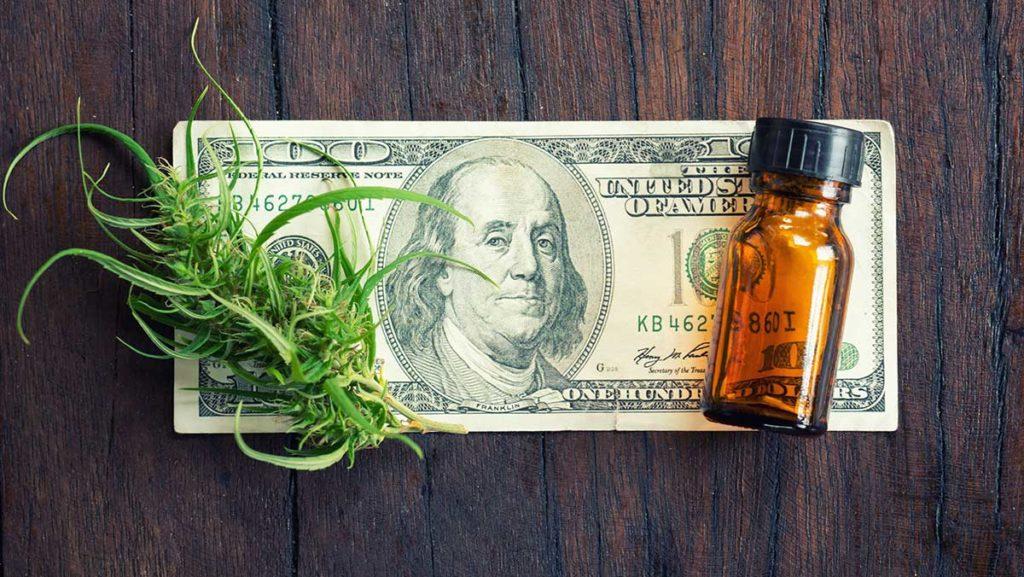 cannabis cannabidiol cbd extract on hundred dollar bill